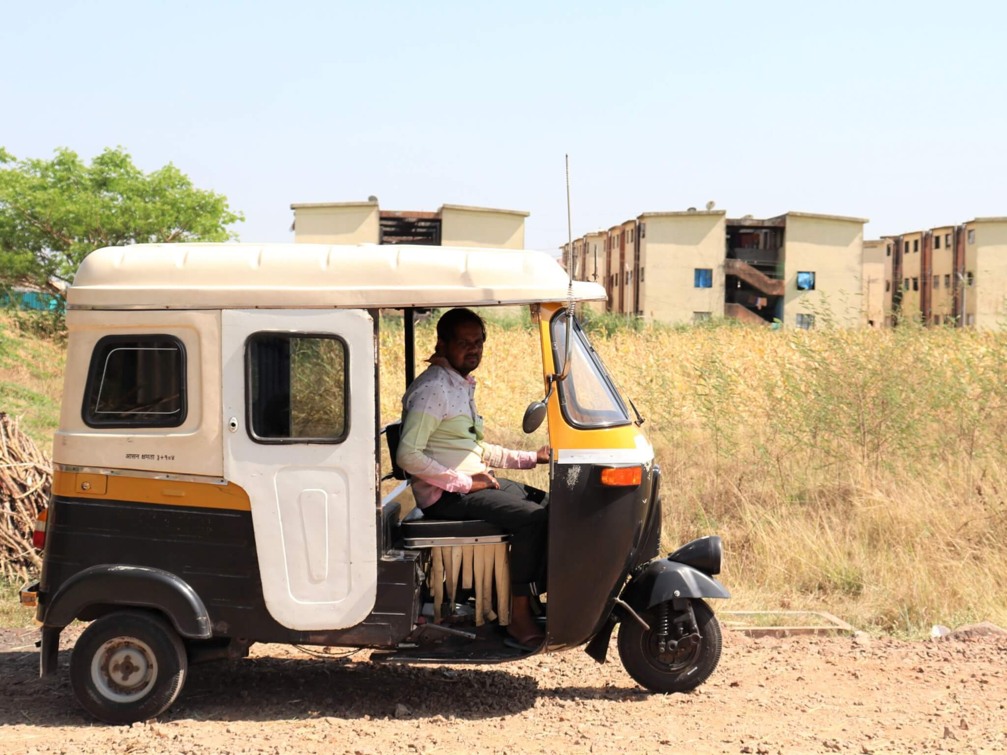 A former tonga driver poses in his auto-rickshaw.