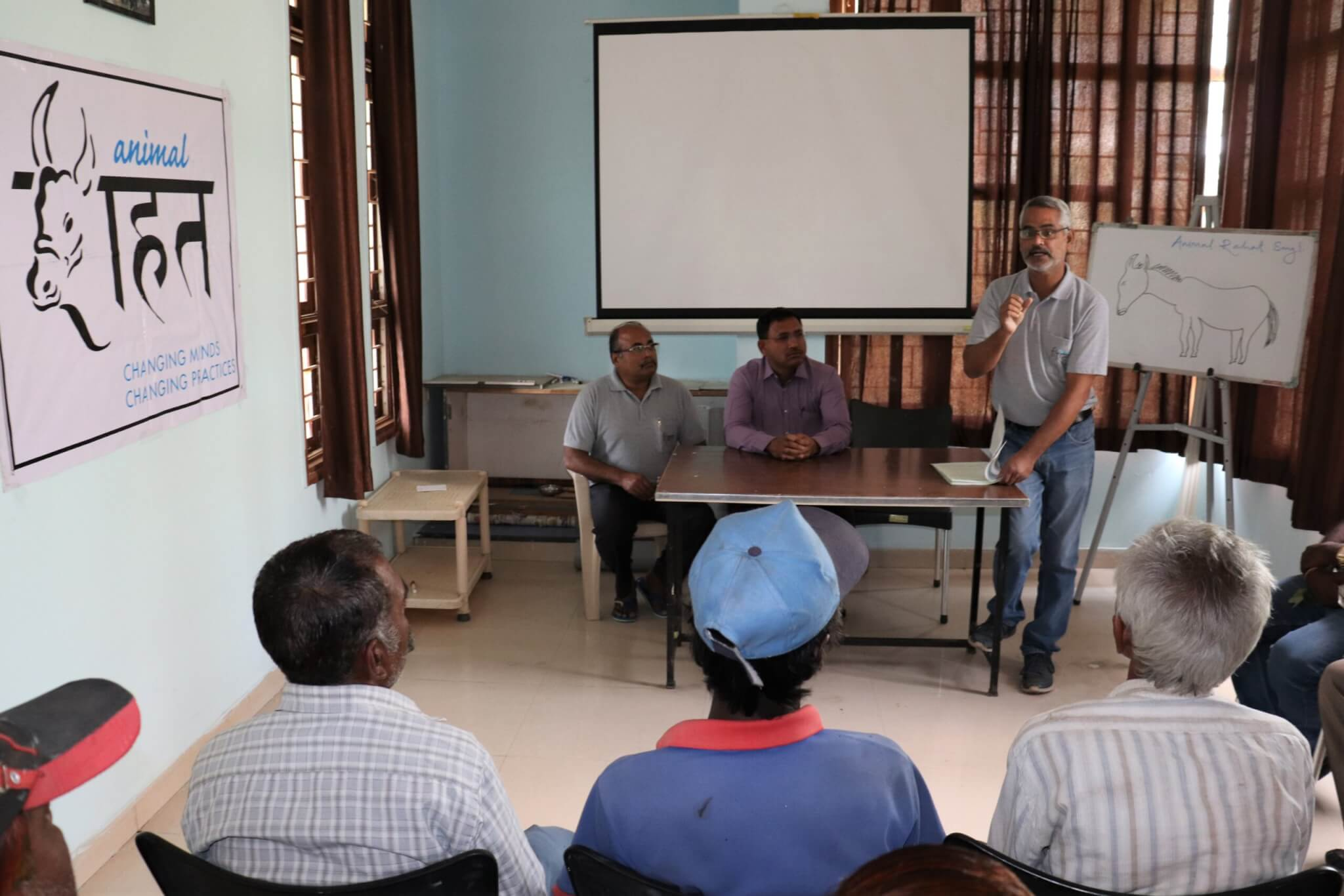 Animal Rahat staffers give a presentation on the importance of mechanizing and how they can help.