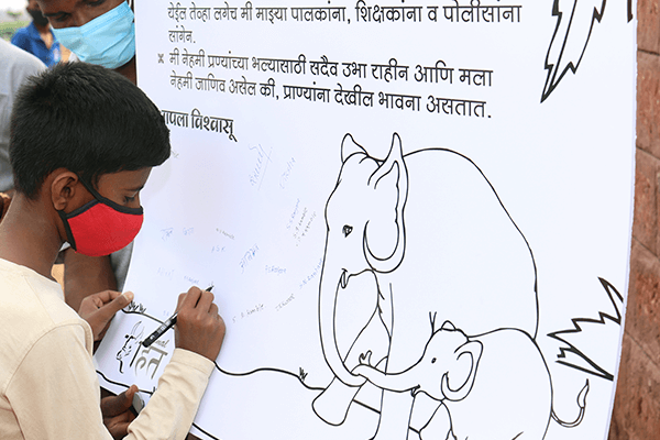 Students sign a pledge to protect animals.